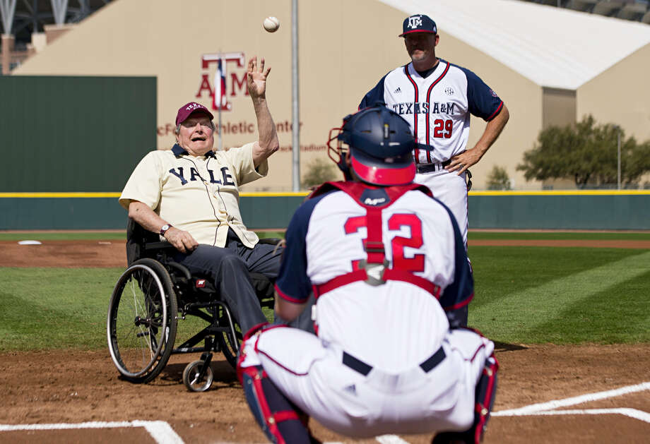 Former President George H. W. Bush throws out an opening pitch to Texas A&M player Stephen Kolek before a college baseball game between Texas A&M and Yale on March 5, 2016 in College Station, Texas. Photo: Timothy Hurst/College Station Eagle Via AP  / College Station Eagle