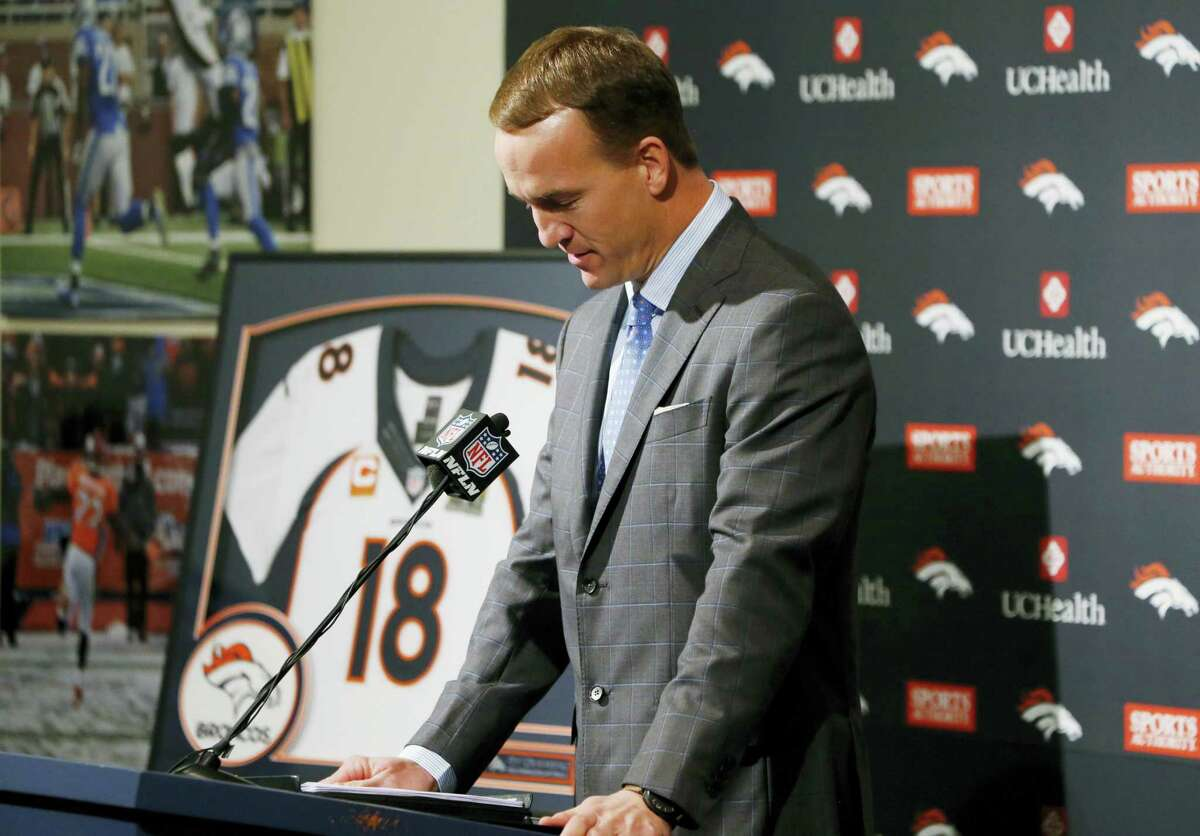 Broncos quarterback Peyton Manning struggles to speak during his retirement announcement at team headquarters Monday in Englewood, Colo.