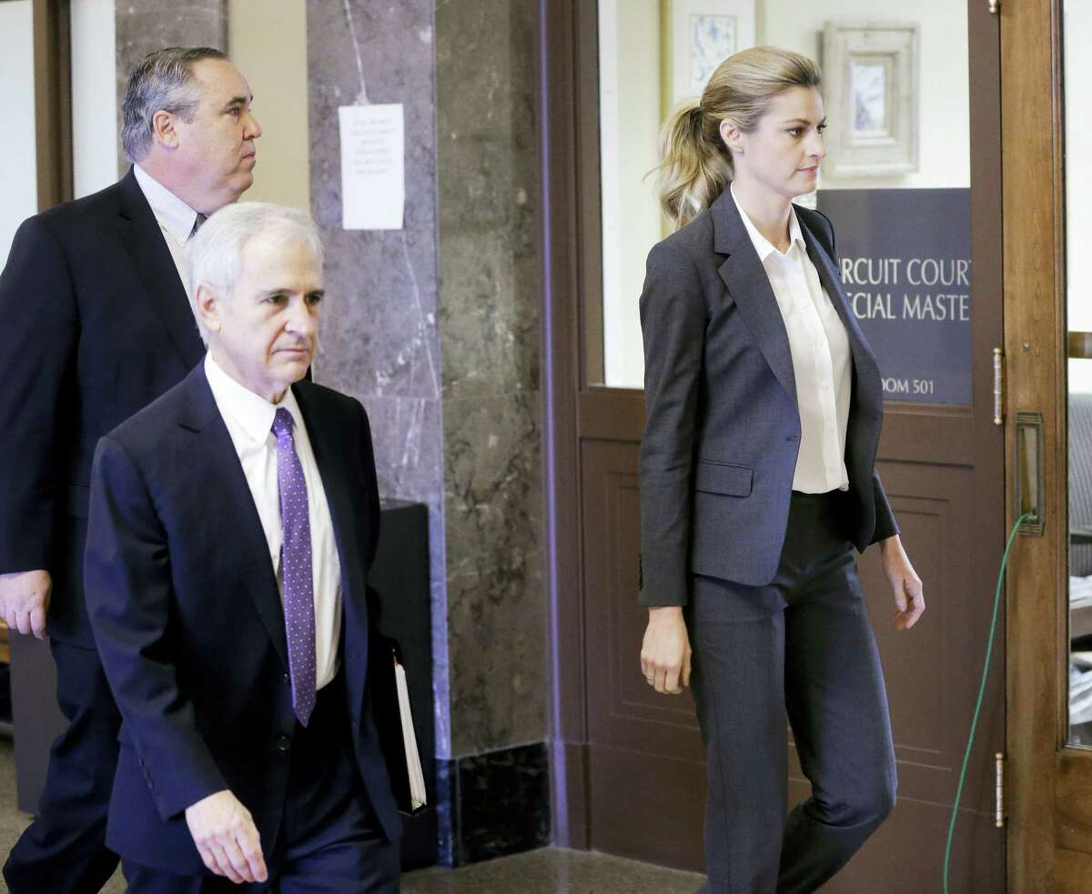 Sportscaster and television host Erin Andrews walks to the courtroom with attorneys Bruce Broillet, center, and Scott Carr, left, Monday in Nashville, Tenn.