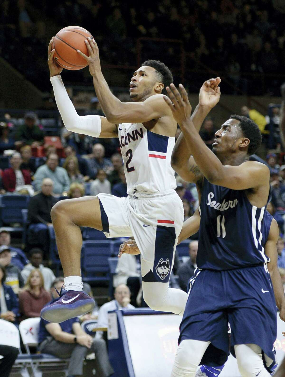 UConn's Jalen Adams drives to the basket during an exhibition against SCSU.