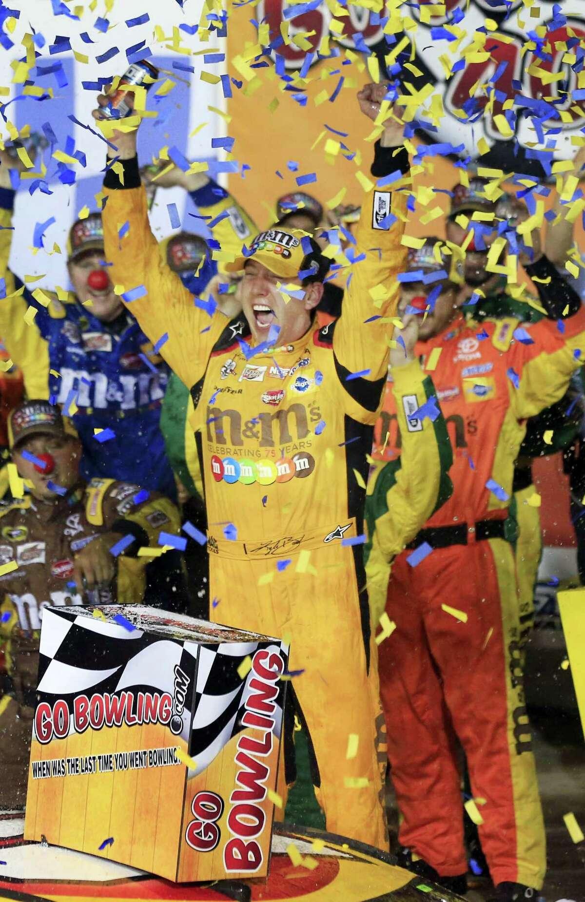 Kyle Busch celebrates after winning at Kansas Speedway on Saturday.