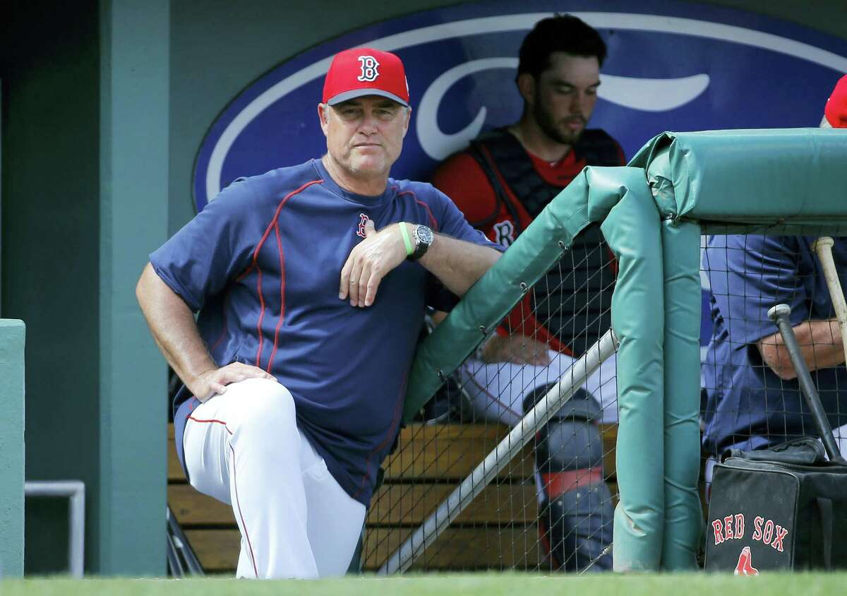 Red Sox manager John Farrell looks on during Monday's spring training game against the Rays.