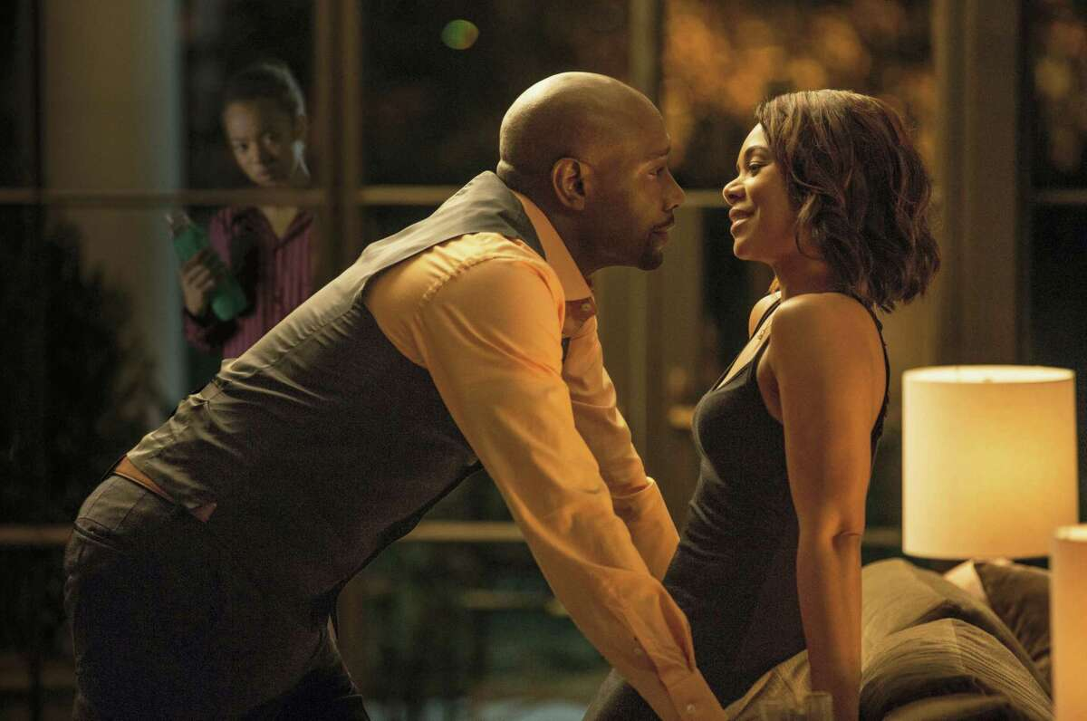 """In this image released by Sony Pictures, Morris Chestnut, left, and Regina Hall appear in a scene from """"When The Bough Breaks."""""""