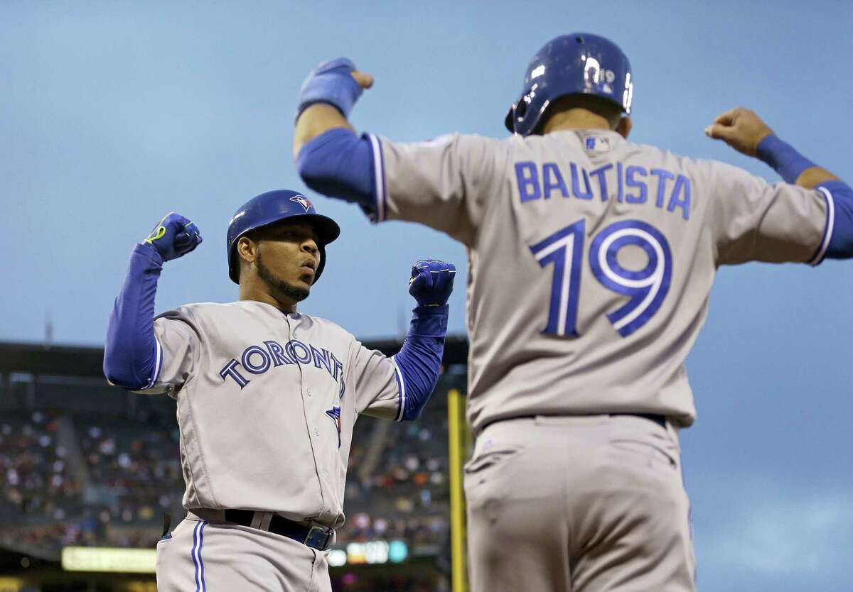 Blue Jays sluggers Edwin Encarnacion, left, and Jose Bautista were among 10 players to receive $17.2 million qualifying offers from their teams on Monday.