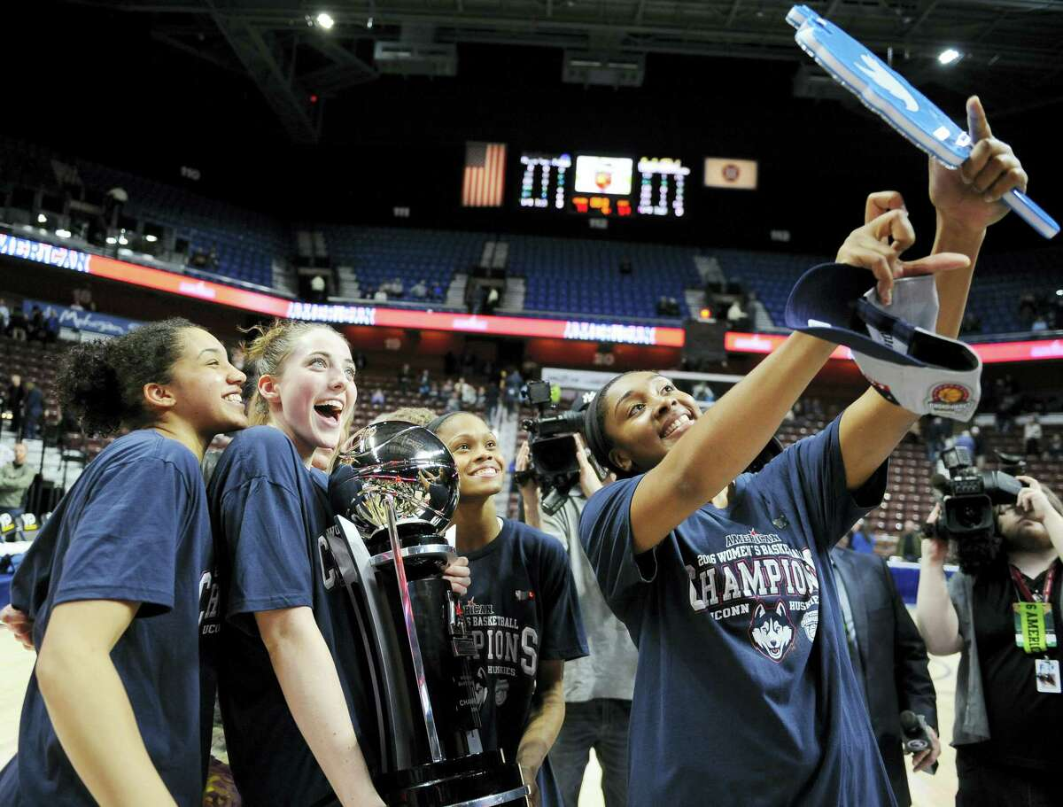 UConn's Morgan Tuck, right, holds up a camera for players Gabby Williams, left, Katie Lou Samuelson, second from left, and Moriah Jefferson after Monday's win.