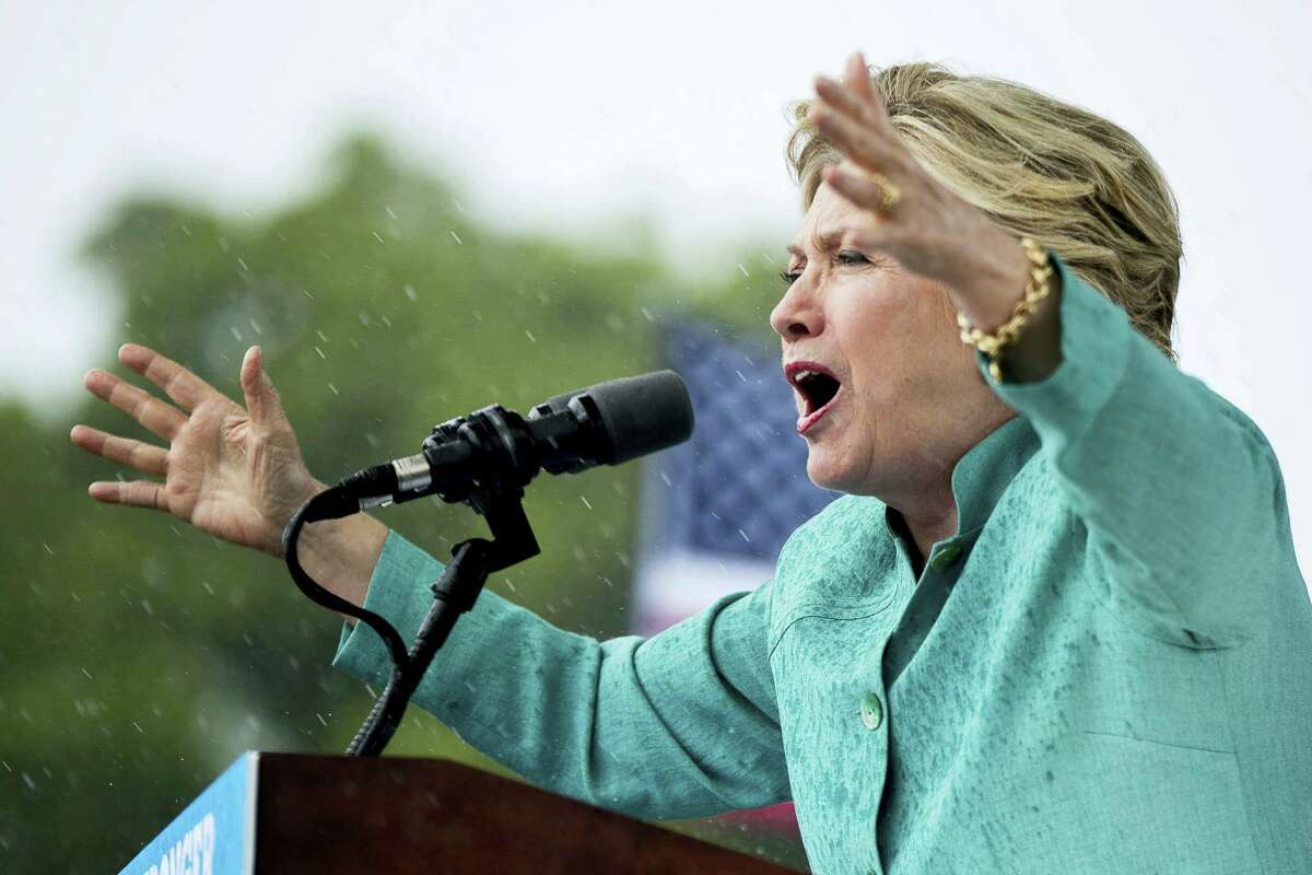 Democratic presidential candidate Hillary Clinton speaks during a heavy rain at a rally at C.B. Smith Park in Pembroke Pines, Fla., Nov. 5..
