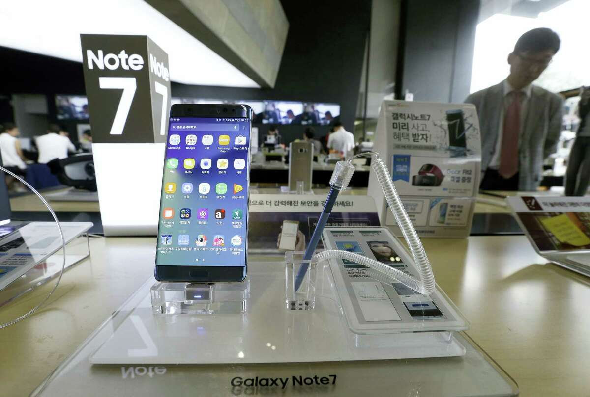 In this Sept. 8, 2016 photo, a Samsung Electronics' Galaxy Note 7 smartphone is displayed at the headquarters of South Korean mobile carrier KT in Seoul, South Korea. Samsung Electronics recommended South Korean customers to stop using the new Galaxy Note 7 smartphones, which the company is recalling worldwide after several dozen of them caught fire.