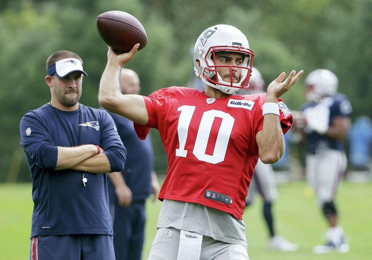Patriots quarterback Jimmy Garoppolo winds up for a pass during a recent practice.