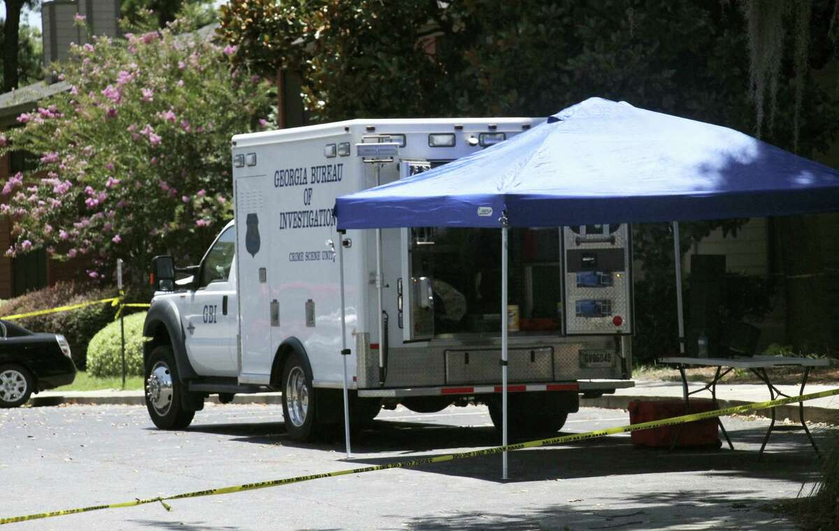 A Georgia Bureau of Investigation vehicles parks near the scene of an officer involved shooting, Friday, July 8, 2016, in Valdosta, Ga. A man who called 911 to report a car break-in Friday ambushed a south Georgia police officer dispatched to the scene, sparking a shootout in which both the officer and suspect were wounded, authorities said. Both are expected to survive.