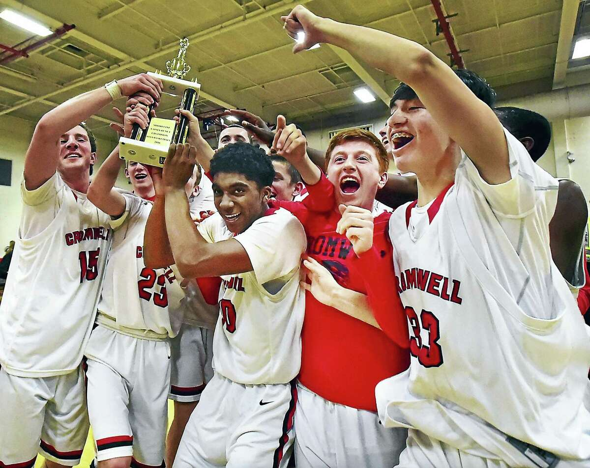 The Cromwell Panthers celebrate their 52-48 win over the Lyme-Old Lyme Wildcats in the Shoreline Conference championship.