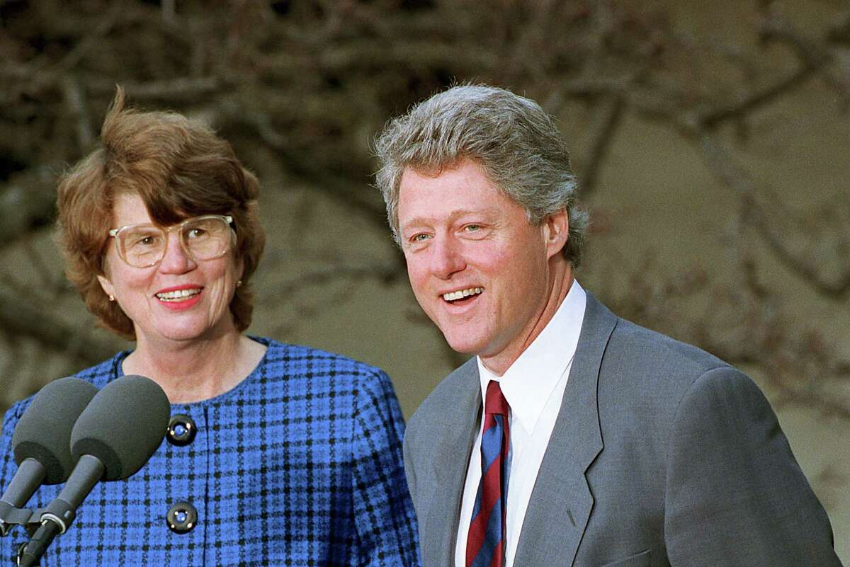 In this Feb. 12, 1993 photo, U.S. President Bill Clinton names Janet Reno the nation's first female attorney general at a ceremony in the Rose Garden at the White House in Washington. Reno, the first woman to serve as U.S. attorney general and the epicenter of several political storms during the Clinton administration, died early Monday, Nov. 7, 2016. She was 78.