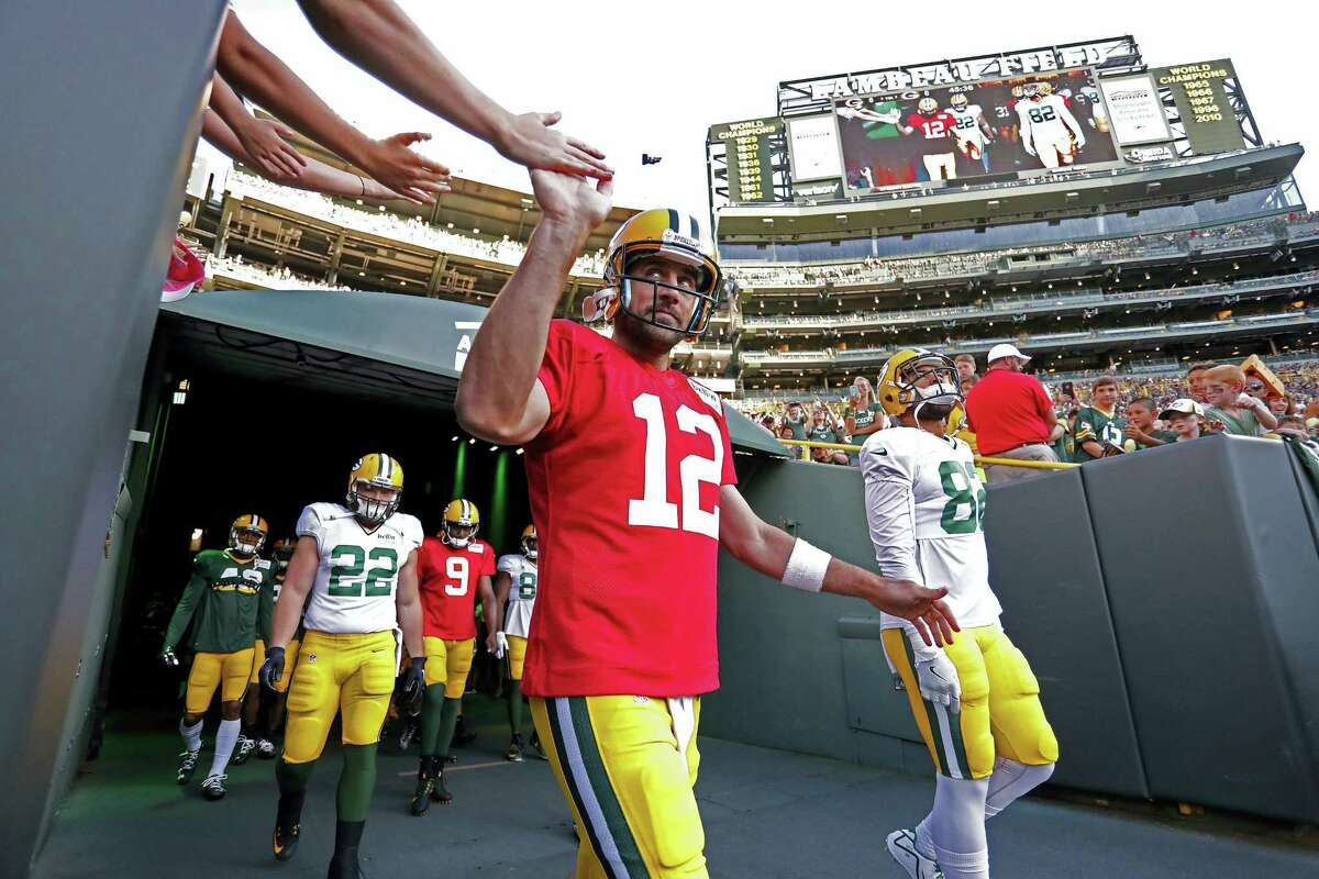Quarterback Aaron Rodgers and the Packers open the season today in Jacksonville against the Jaguars.