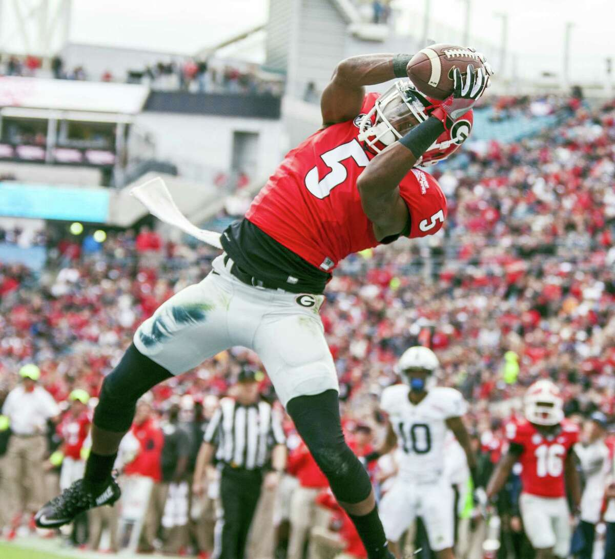 Georgia wide receiver Terry Godwin catches a touchdown during the first half of the TaxSlayer Bowl against Penn State on Saturday in Jacksonville, Fla.