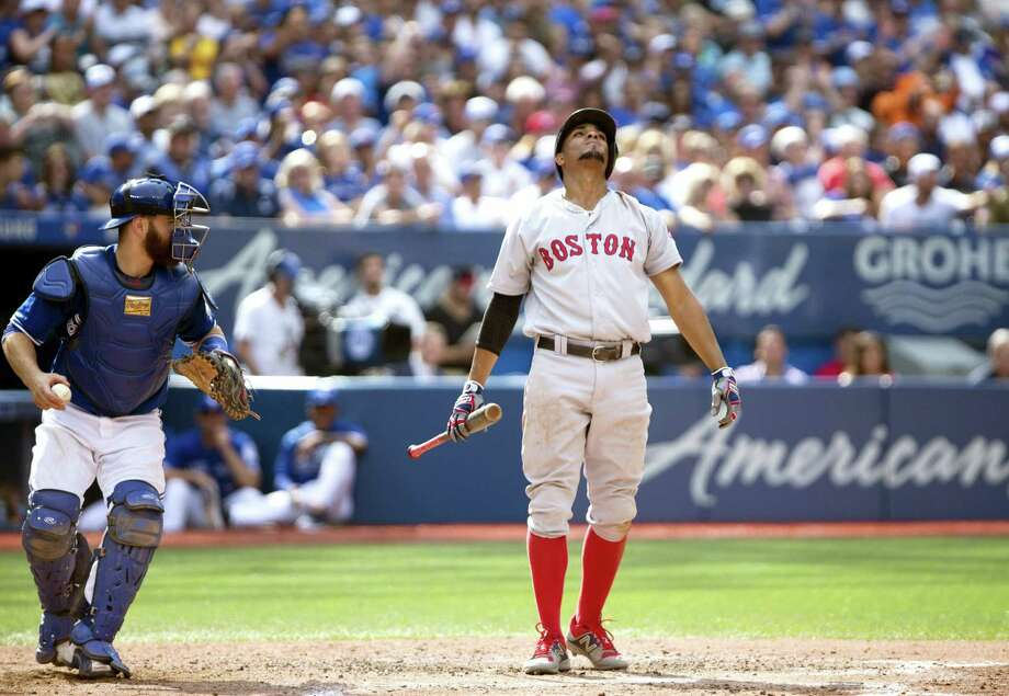 Xander Bogaerts (2) reacts after striking out in the eighth inning on Saturday. Photo: Peter Power — The Canadian Press Via AP  / CP