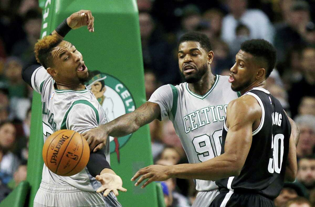 Thaddeus Young (30) and the Nets beat Jared Sullinger, left, Amir Johnson (90) and the Celtics on Saturday in Boston.
