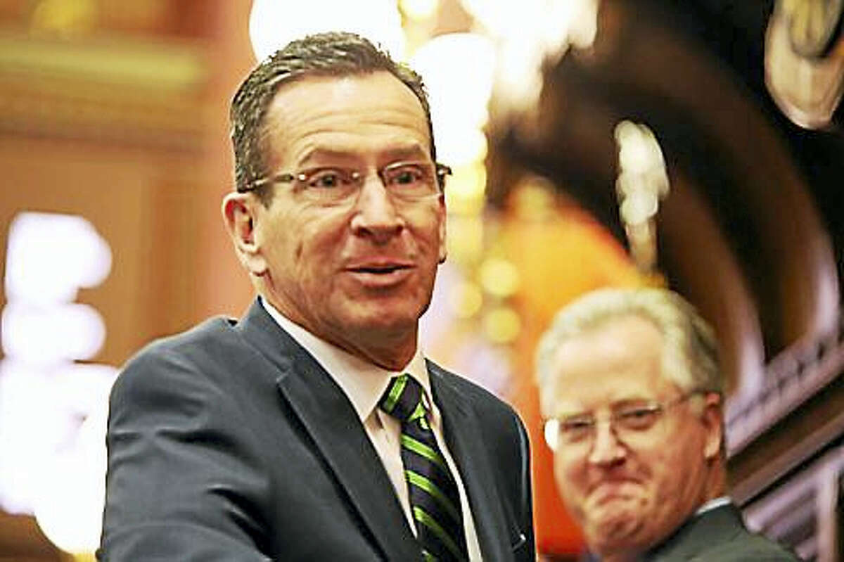 In this Feb. 3 file photo, Gov. Dannel P. Malloy and House Speaker Brendan Sharkey are photographed on opening day.