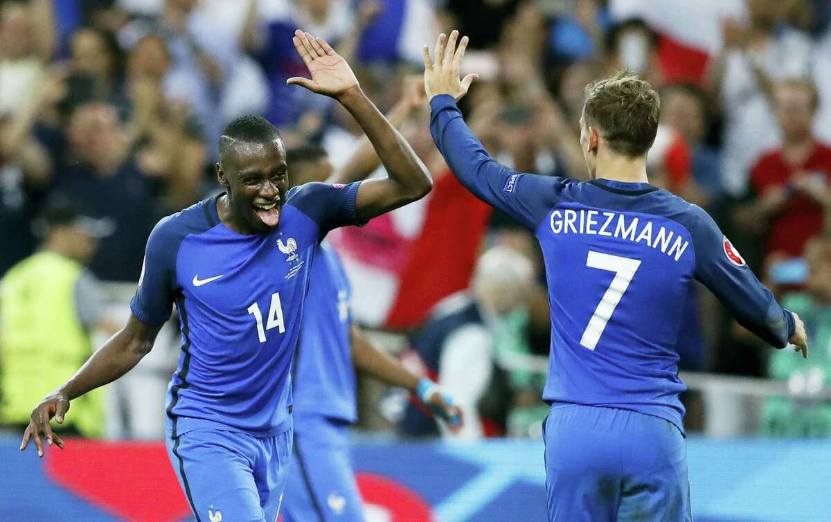 France's Antoine Griezmann, right, celebrates with Blaise Matuidi at the end of Thursday's Euro 2016 semifinal in Marseille, France.
