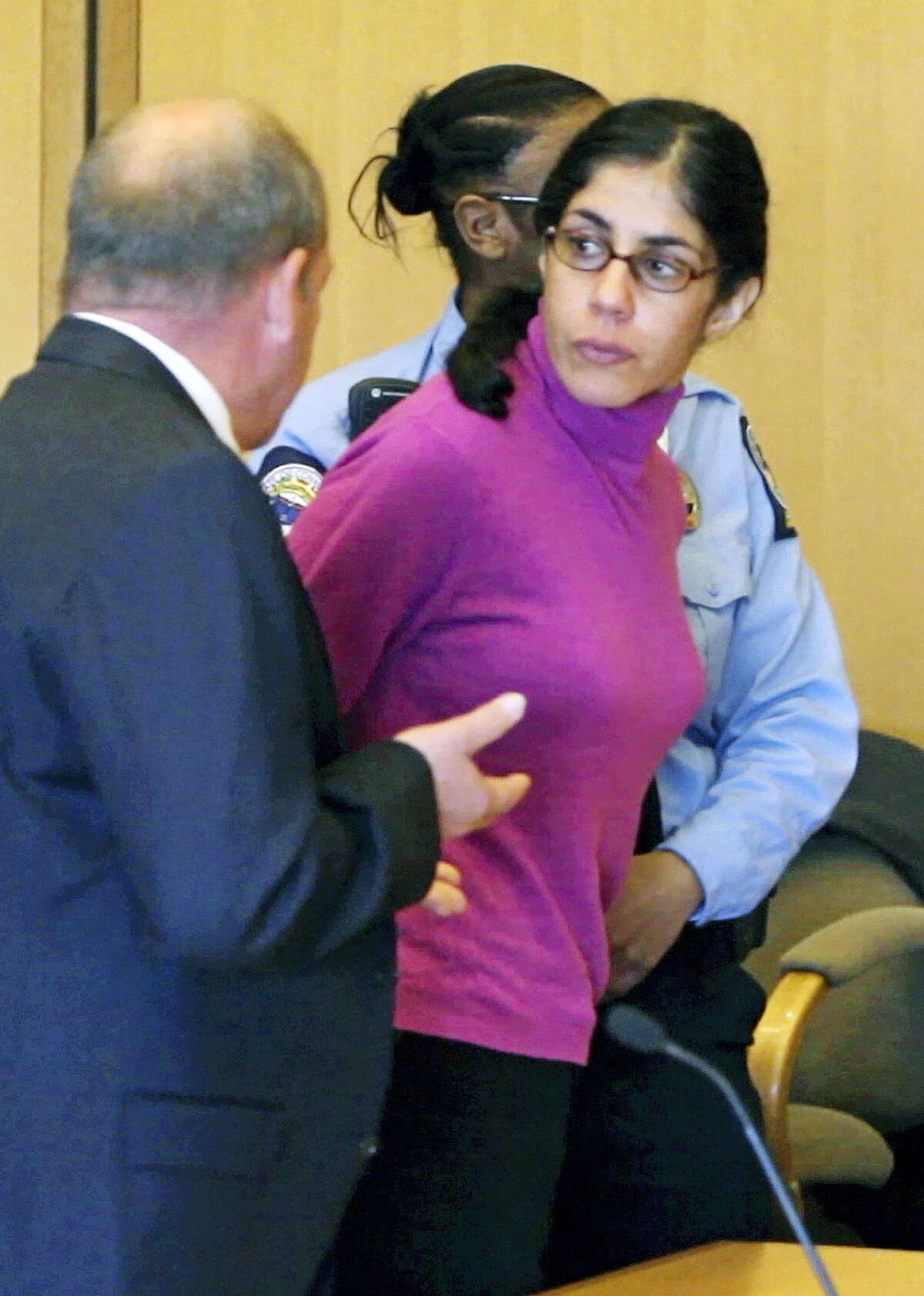 In this April 27, 2012 file photo, Sheila Davalloo looks back in Superior Court in Stamford Conn., following her sentencing for the 2002 murder of Anna Lisa Raymundo. The Connecticut Supreme Court ruled Thursday, Dec. 31, 2015, against an appeal by Davallo, saying that a state law protecting married couple's conversations as confidential does not apply to the convicted killer, who protested the use of self-incriminating comments she made to her husband as evidence against her at trial.