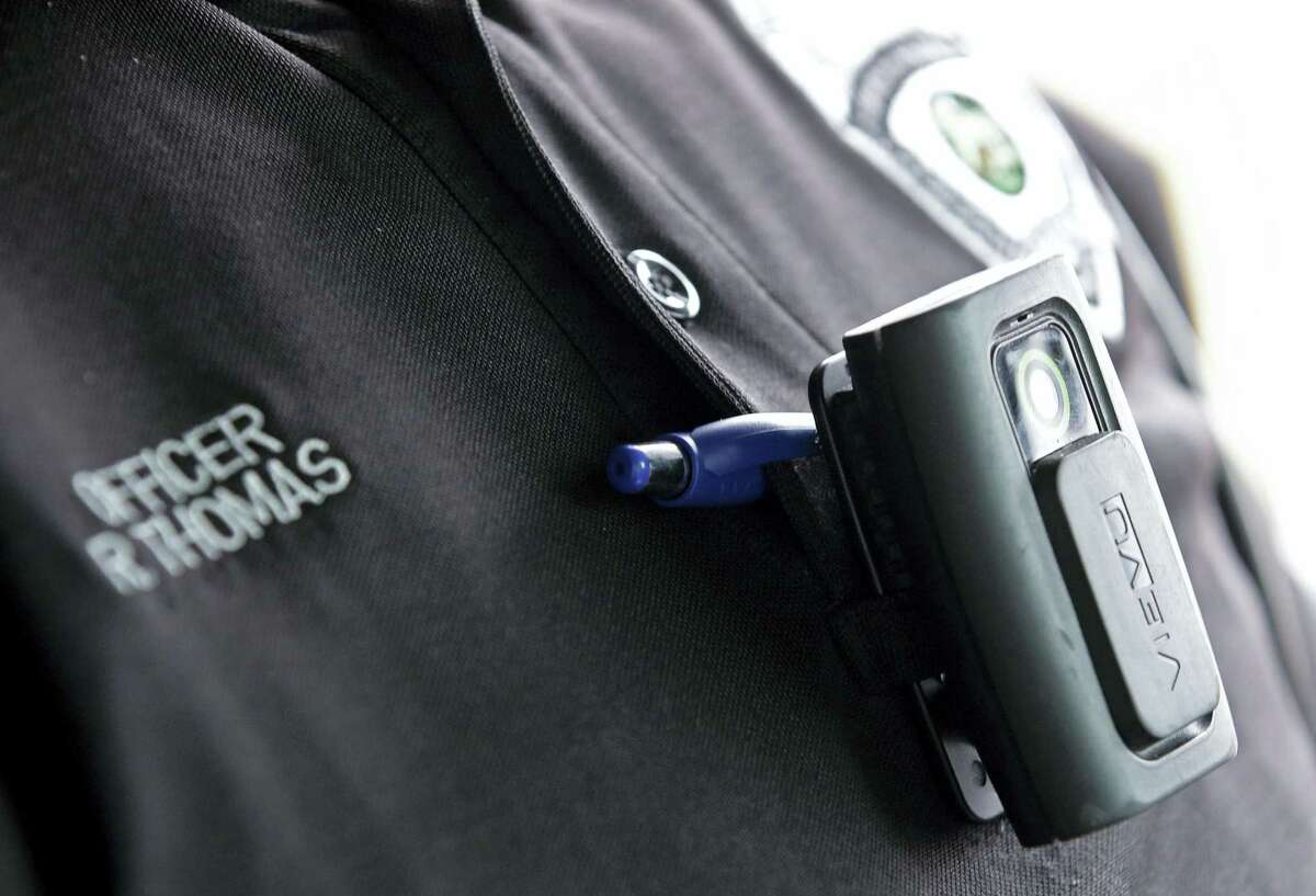 In this file photo taken on Tuesday, Sept. 29, 2015, a body camera is attached to the uniform of Whitestown Police Department officer Reggie Thomas during a traffic stop, in Whitestown, Ind. Police departments in at least two states are shelving the body cameras they outfitted their officers with, blaming the formidable costs of storing the video. About a third of the nation's 18,000 police agencies either have pilot body camera programs or full programs in place, despite the cost concerns.