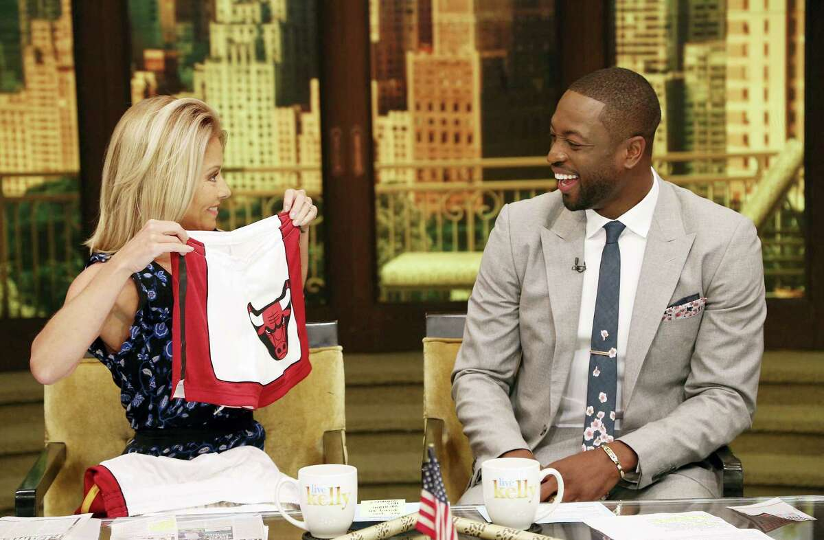 The Associated Press TV host Kelly Ripa and NBA basketball player Dwyane Wade chat on Thursday. Wade decided Wednesday night that he will leave the Heat after 13 seasons, agreeing to terms on a two-year-$47 million contract with the Chicago Bulls.