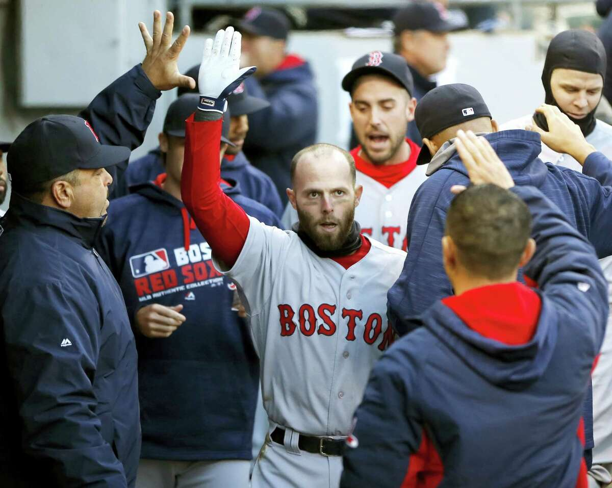 Boston Red Sox's Dustin Pedroia celebrates his home run off Chicago White Sox starting pitcher Erik Johnson in the dugout during the first inning of a baseball game, Thursday, May 5, 2016, in Chicago. (AP Photo/Charles Rex Arbogast)