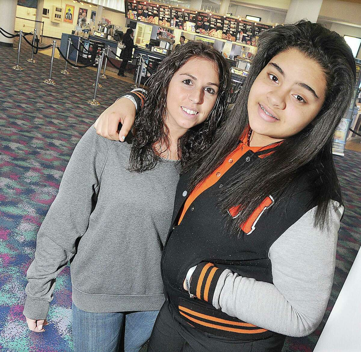 CATHERINE AVALONE — THE MIDDLETOWN PRESS FILE PHOTO Cromwell resident Jenna Director, then 22, at left, and her Little Sister Jaiyah Kimber, then 14, at Rave Cinemas in Berlin in this file photo from 2013.