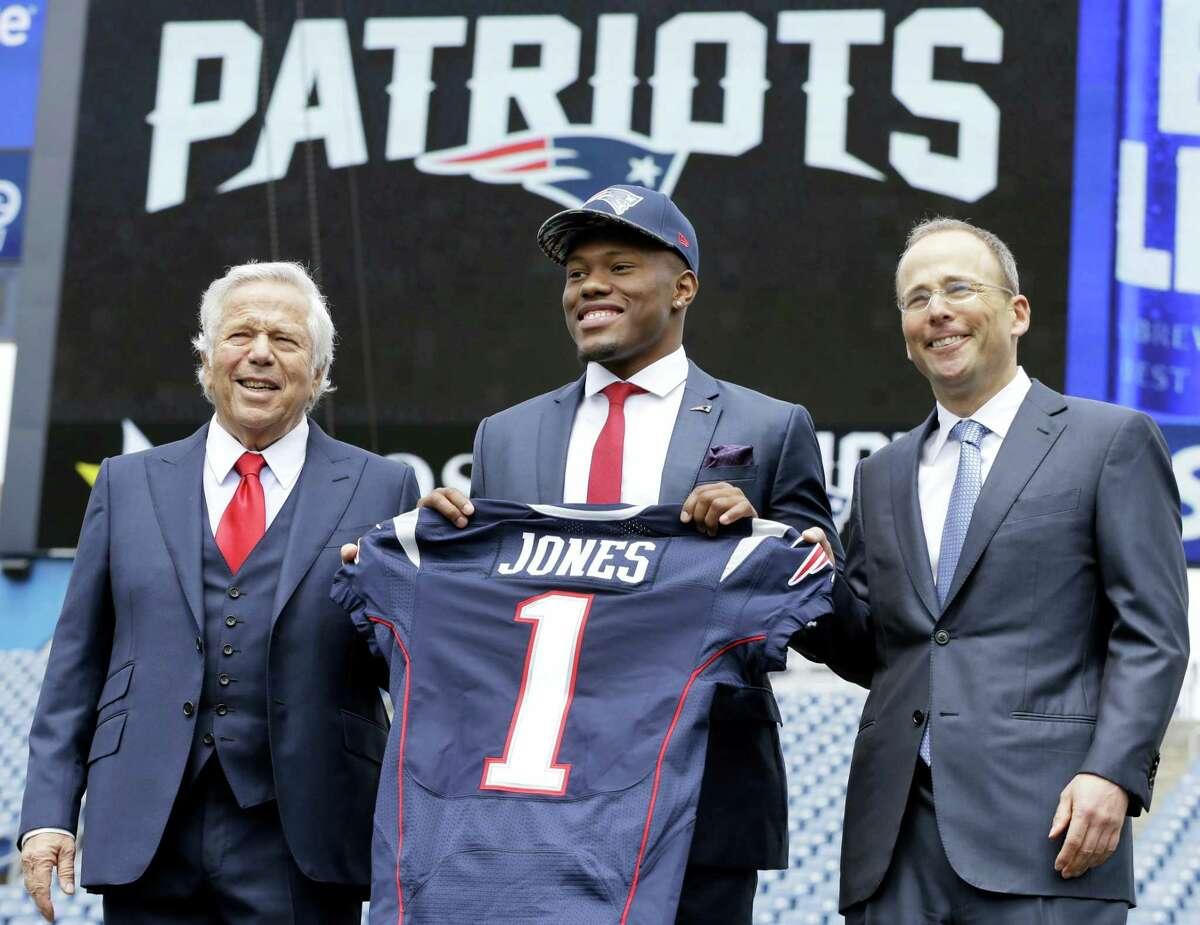 New England Patriots top draft pick Cyrus Jones is introduced by team owner Robert Kraft, left, and team president Jonathan Kraft, right, at Gillette Stadium, Friday.