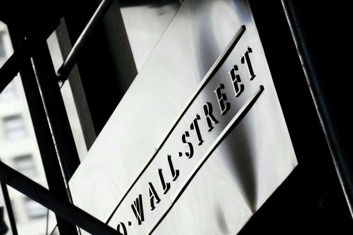 A sign for Wall Street outside the New York Stock Exchange, in New York.