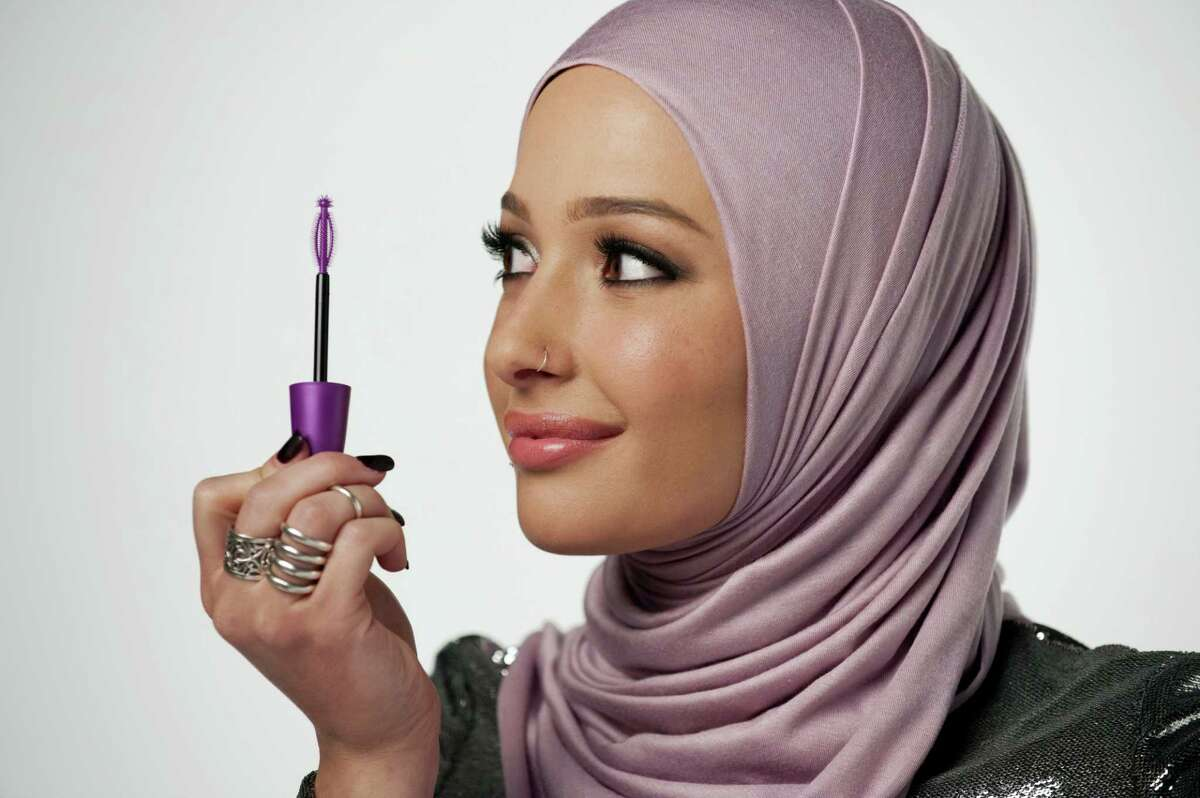 In this undated photo provided by CoverGirl, beauty blogger Nura Afia poses for a photo. CoverGirl is featuring a woman wearing a hijab in its advertising for the first time in the makeup line's history.