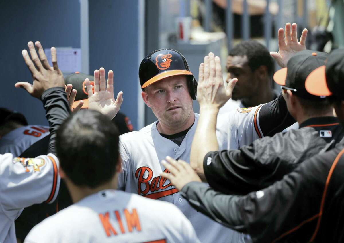 The Orioles' Mark Trumbo, center, will be part of the Home Run Derby in San Diego on Monday.