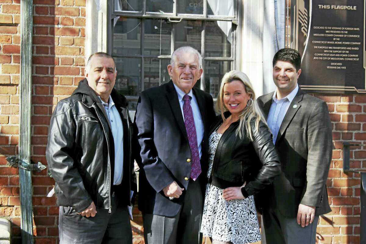 All American Productions, an event planning organization specializing in charity fundraisers for veterans, recently became a member of the Middlesex County Chamber of Commerce. From left are Middletown Motorcycle Mania chairman Richard Greco, Chamber president Larry McHugh, Jennifer Sequenzia, owner of All American Productions; and Middletown Mayor Dan Drew.