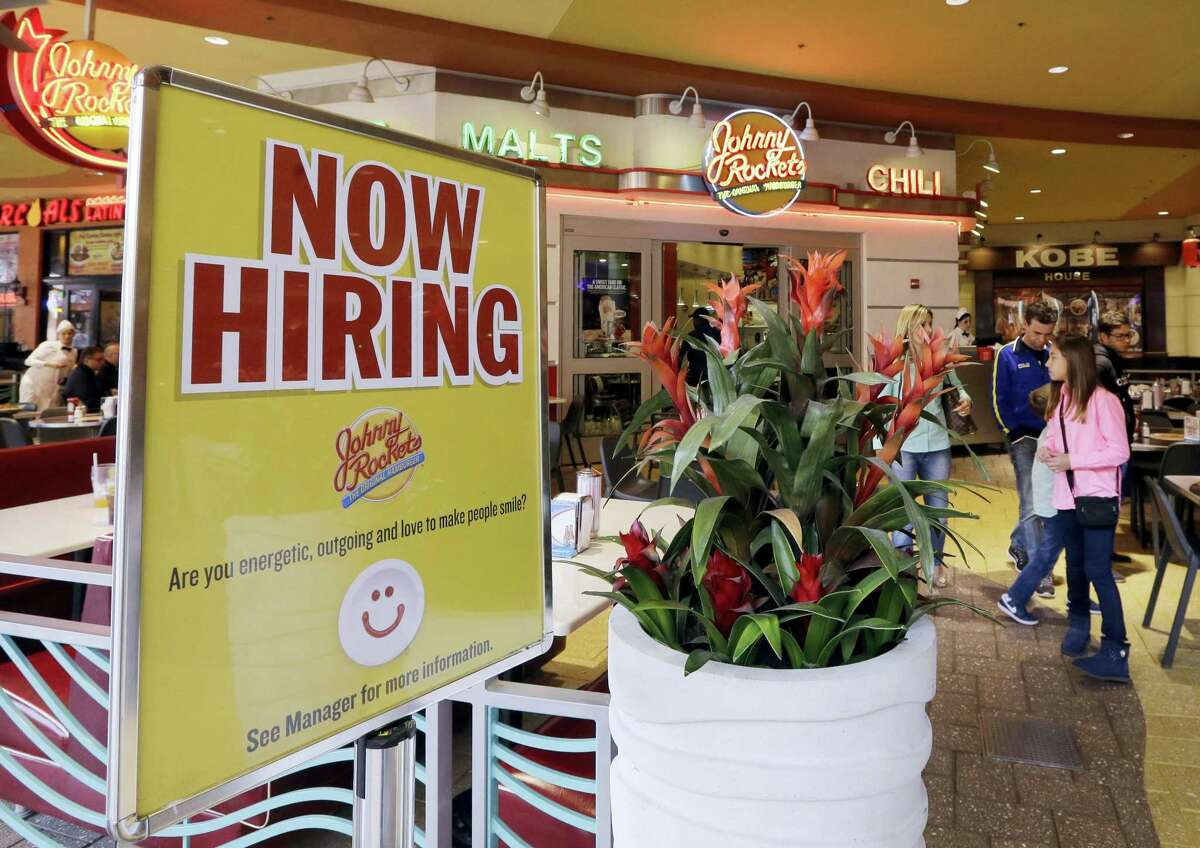 A restaurant posts a sign indicating they are hiring, in Miami. On Thursday, May 5, 2016, the Labor Department releases its weekly report on applications for unemployment benefits.