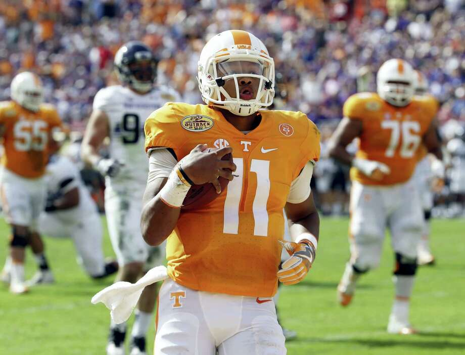 Tennessee quarterback Joshua Dobbs runs 14 yards for a touchdown against Northwestern during the first quarter of the Outback Bowl on Friday in Tampa, Fla. Photo: Chris O'Meara — The Associated Press  / AP