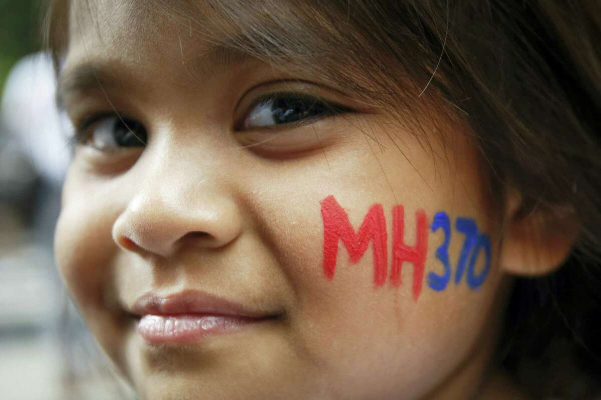 A Malaysian child has her face painted with MH370 during a remembrance event for the ill fated Malaysia Airlines Flight 370 in Kuala Lumpur, Malaysia on March 6, 2016.