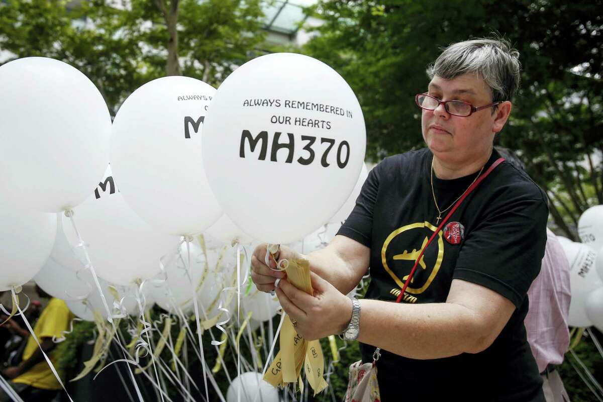 Jacquita Gomes, wife of Patrick Gomes, the in-flight supervisor on the ill fated Malaysia Airlines Flight 370, prepares balloons with names of those on board during a remembrance event in Kuala Lumpur, Malaysia on March 6, 2016.