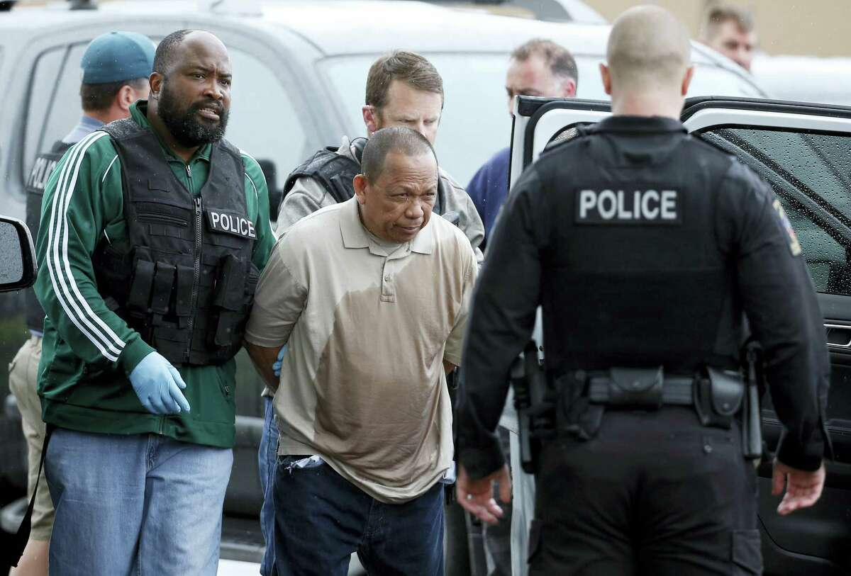 Police take Eulalio Tordil, 62, a suspect in three fatal shootings in the Washington, D.C., area into custody in Silver Spring, Md., Friday, May 6, 2016. Tordil is an employee of the Federal Protective Service, which provides security at federal properties. He was put on administrative duties in March after a protective order was issued against him.