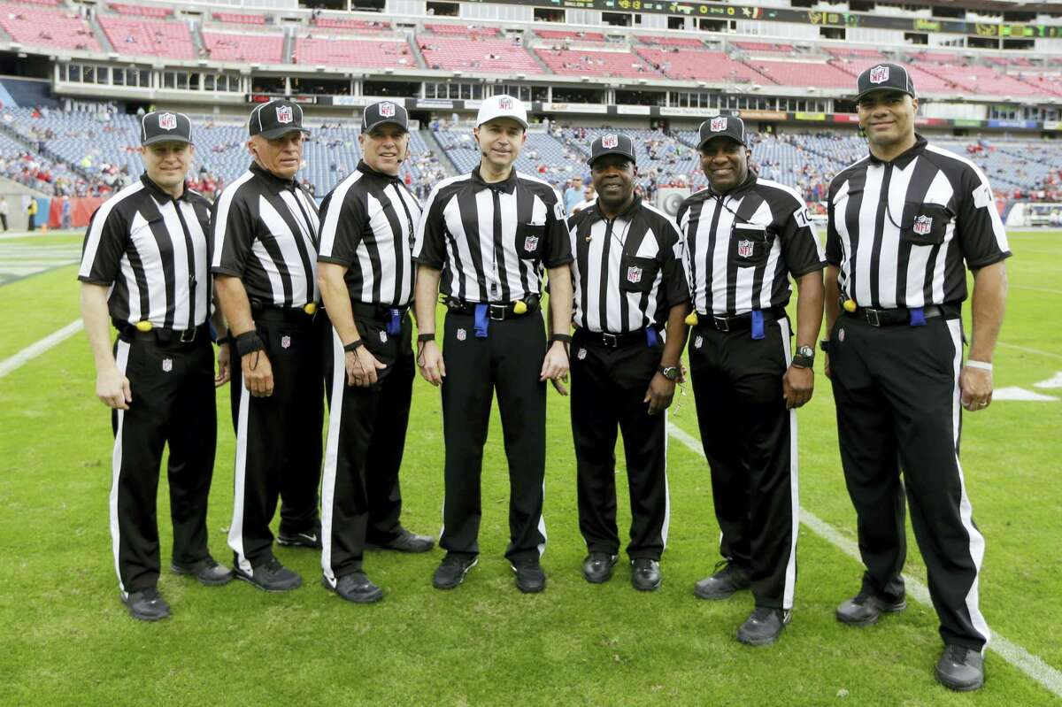 Officials pose before a game between the Titans and Texans Sunday in Nashville, Tenn.