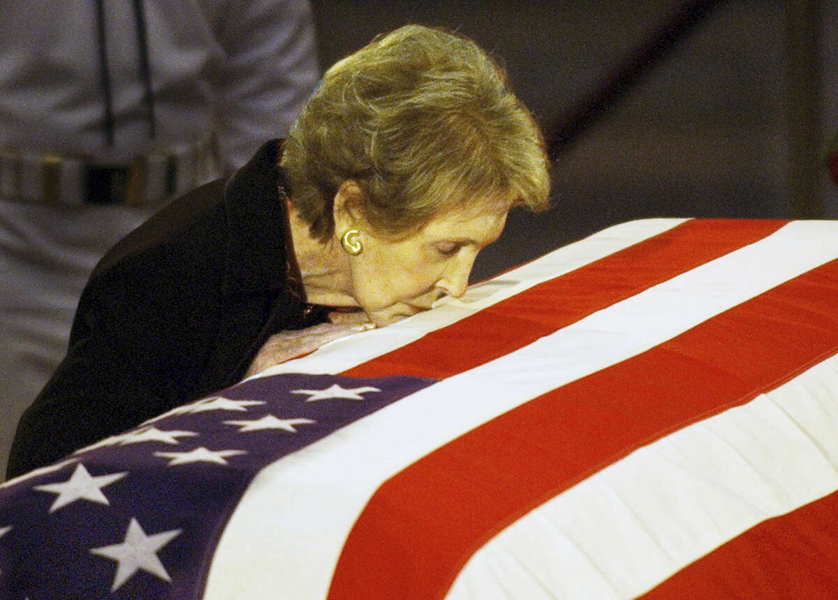 In this June 11, 2004 photo, former first lady Nancy Reagan kisses the casket of her husband former President Ronald Reagan prior to the removal of his remains from the Capitol Rotunda in Washington.