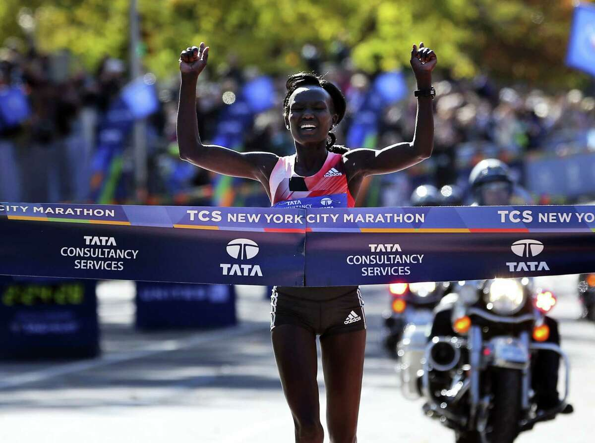 Mary Keitany of Kenya crosses the finish line first in the women's division of the 2016 New York City Marathon in New York on Nov. 6, 2016.