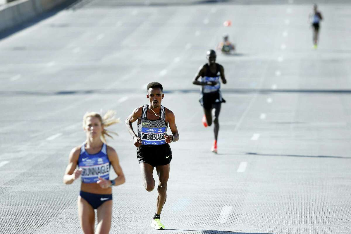 Ghirmay Ghebreslassie, of Eritrea, second left, pulls away from Kenya's Lucas Rotich, second right, and Lelisa Desisa, of Ethiopia, far right, during the New York City Marathon on Nov. 6, 2016 in New York.