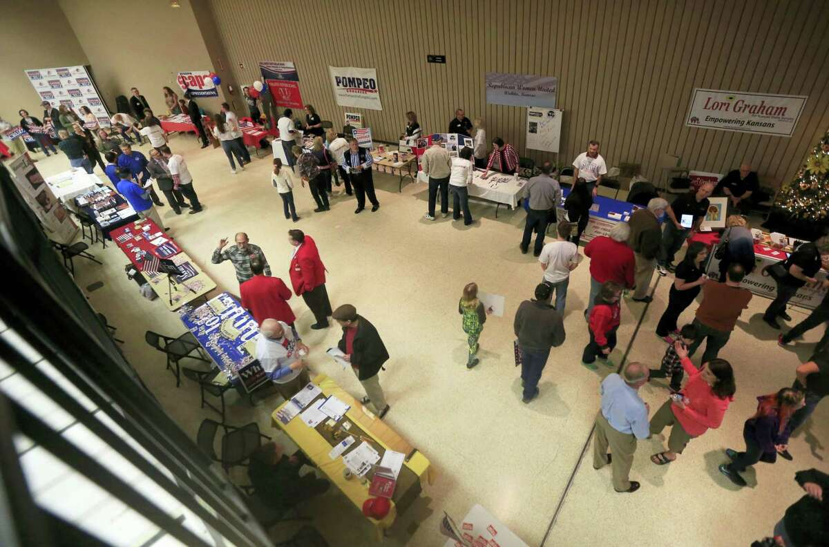 Republican candidates for office in the 2016 Kansas state caucus have informational tables in the hallway at a caucus site on March 5, 2016 in Wichita, Kan.