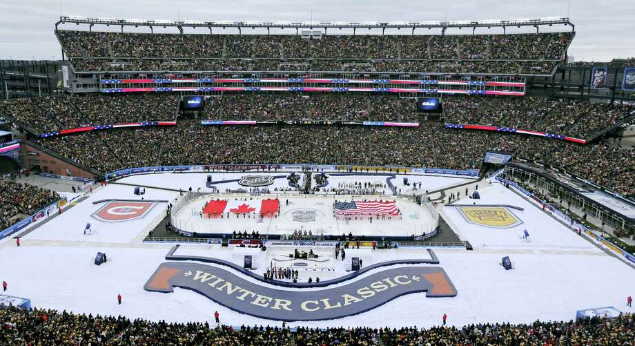 The Canadian and American flags are presented during the national anthems prior the Winter Classic between the Bruins and Canadiens on Friday at Gillette Stadium in Foxborough, Mass. Photo: Charles Krupa — The Associated Press  / AP