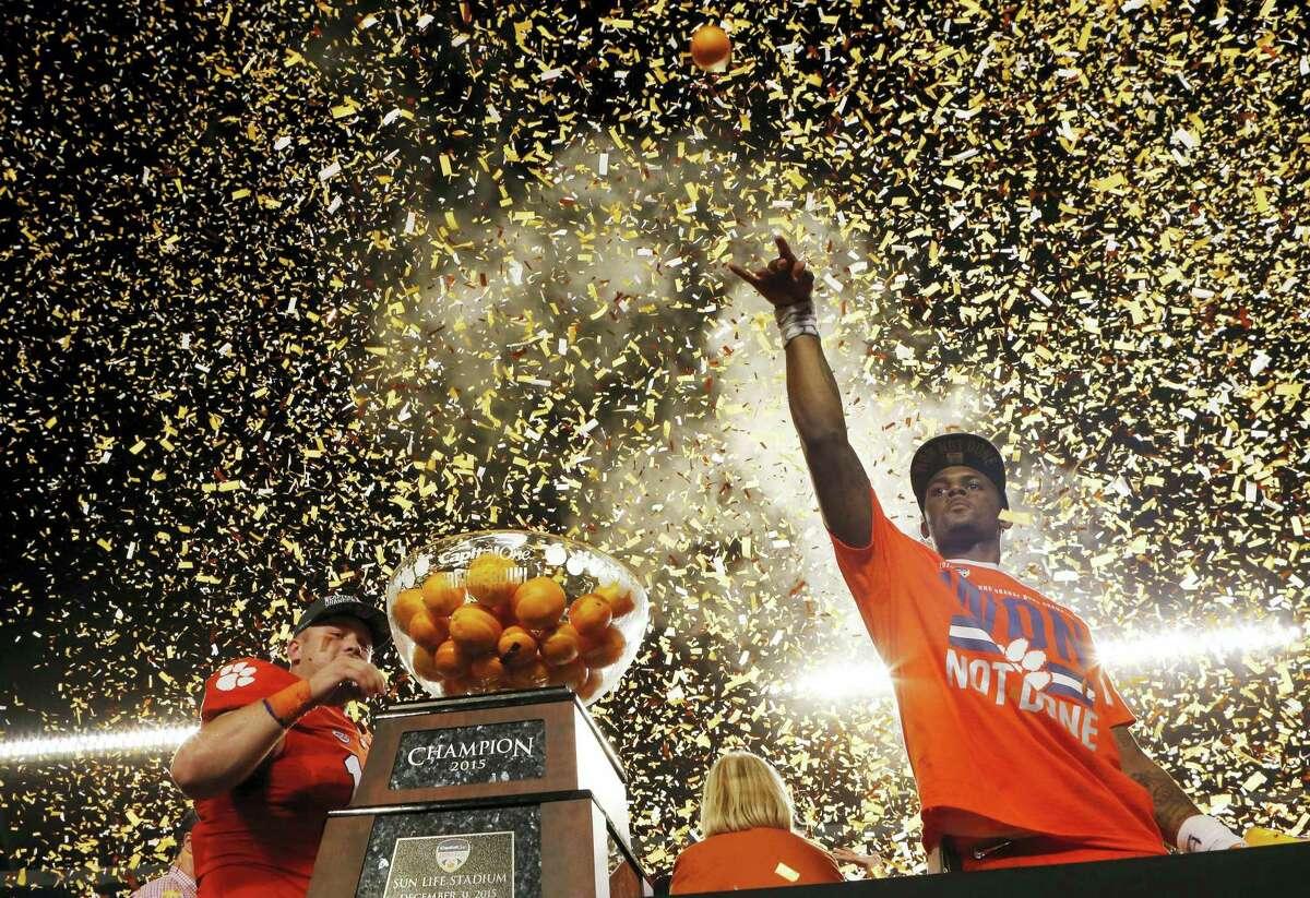 Clemson quarterback Deshaun Watson throws oranges to the crowd after his Tigers won the Orange Bowl college football playoff semifinal game against Oklahoma on Thursday in Miami Gardens, Fla.