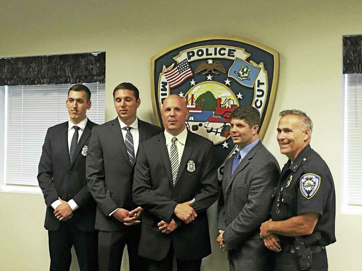 Middletown police officers, from left, Stefan Inglis, Michael Pellegrini and David Skarzynski, who joined the force on June 30, are shown with Mayor Dan Drew and Police Chief William McKenna at headquarters on Main Street.