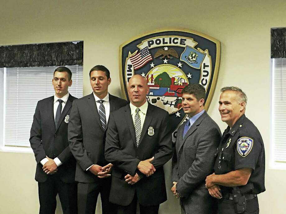 Middletown police officers, from left, Stefan Inglis, Michael Pellegrini and David Skarzynski, who joined the force on June 30, are shown with Mayor Dan Drew and Police Chief William McKenna at headquarters on Main Street. Photo: Courtesy Photo