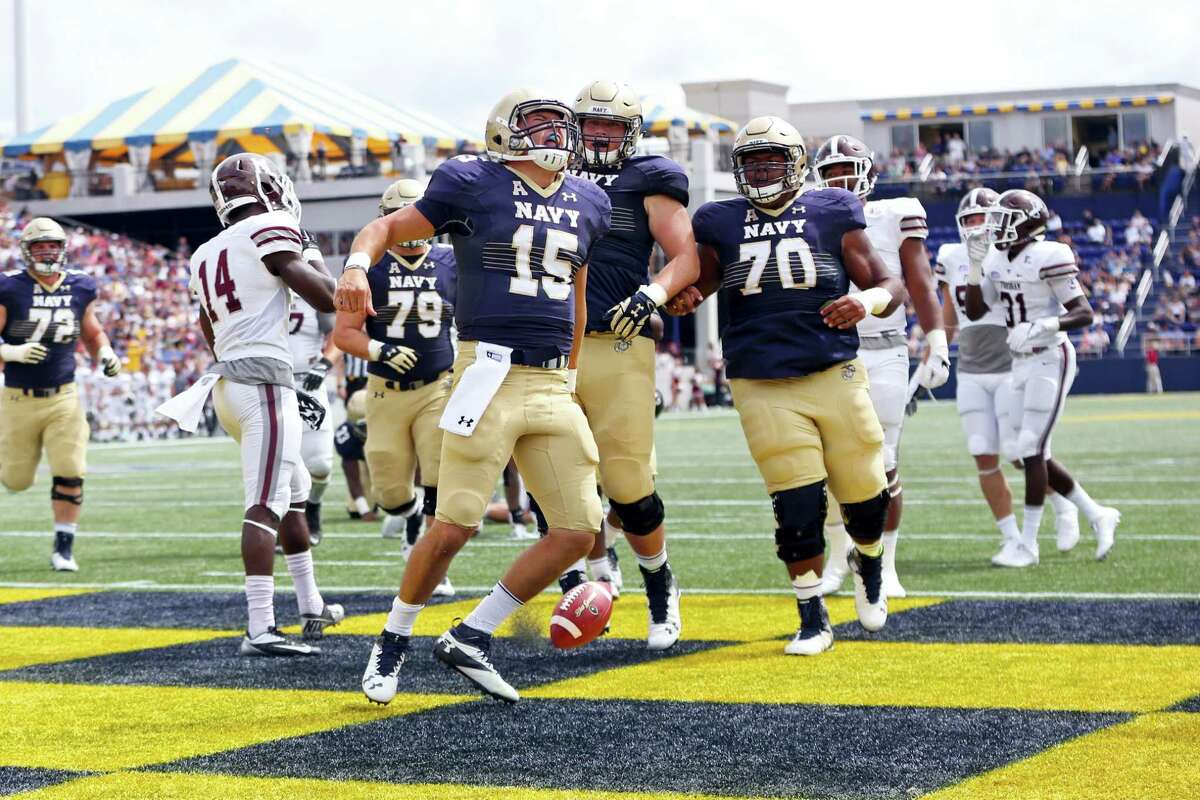 Navy's Will Worth (15) celebrates a touchdown against Fordham earlier this season.