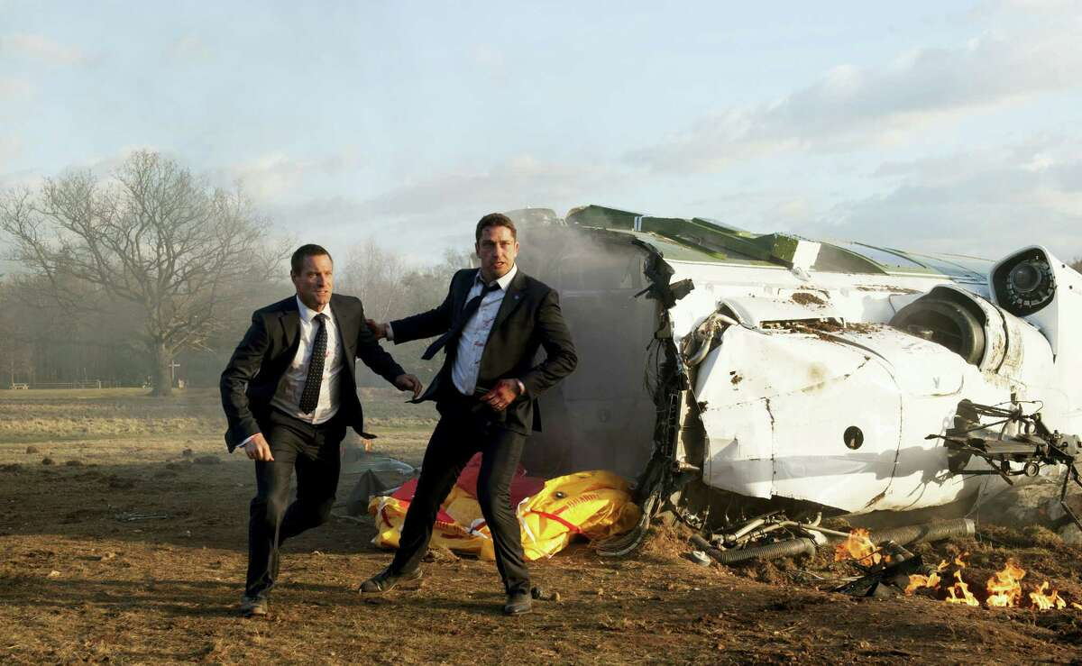"""This image released by Focus Features shows Aaron Eckhart, left, and Gerard Butler in a scene from Grammercy Pictures' """"London Has Fallen."""""""