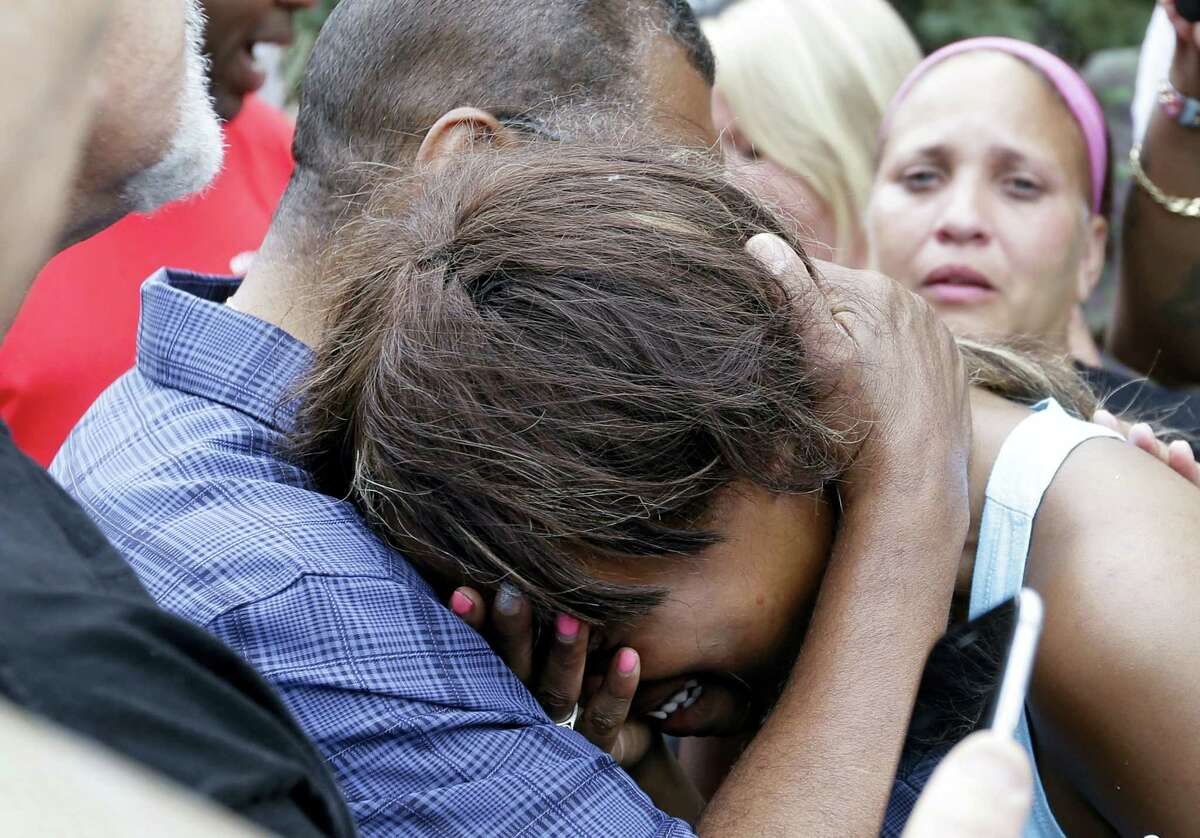 Diamond Reynolds, the girlfriend of Philando Castile is consoled by a minister outside the governor's residence in St. Paul, Minn., on Thursday, July 7, 2016. Castile was shot and killed after a traffic stop by police in Falcon Heights, Wednesday night. A video shot by Reynolds of the shooting went viral.