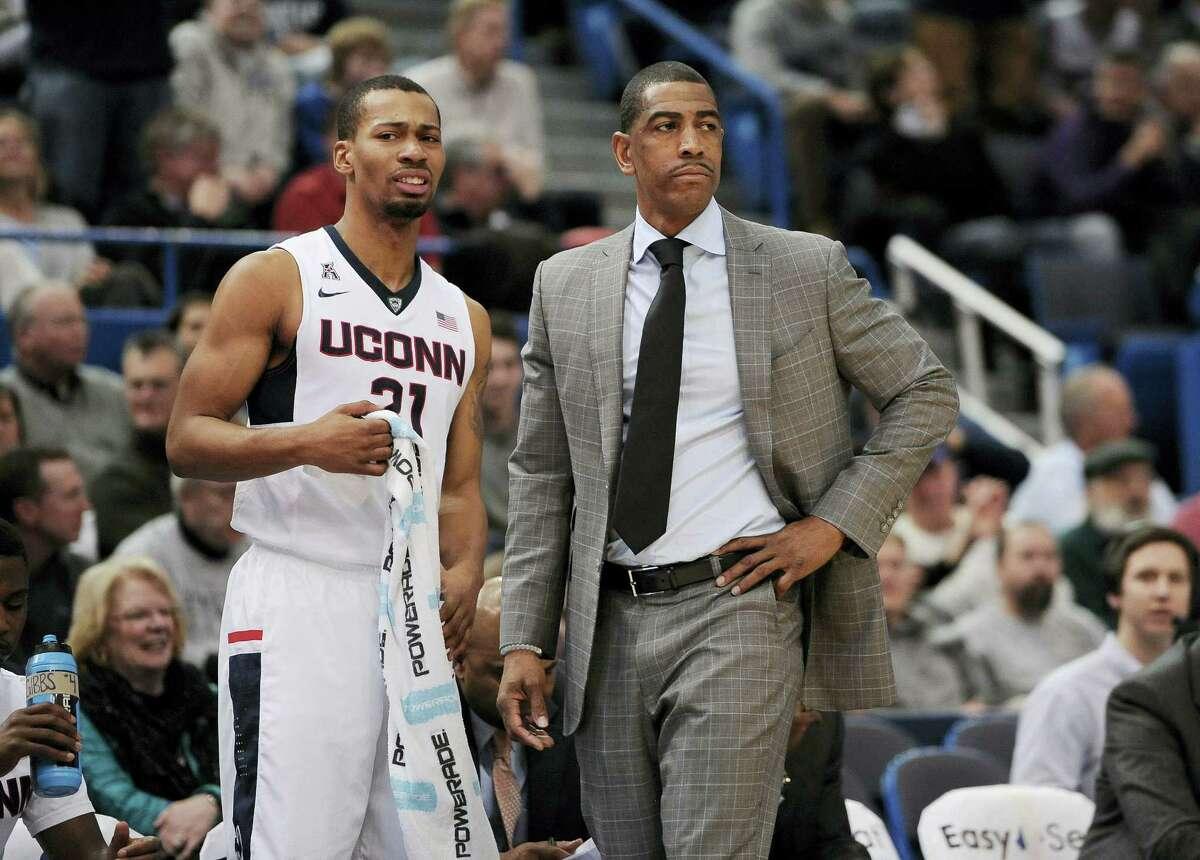 UConn head coach Kevin Ollie talks with Omar Calhoun during a game earlier this season.