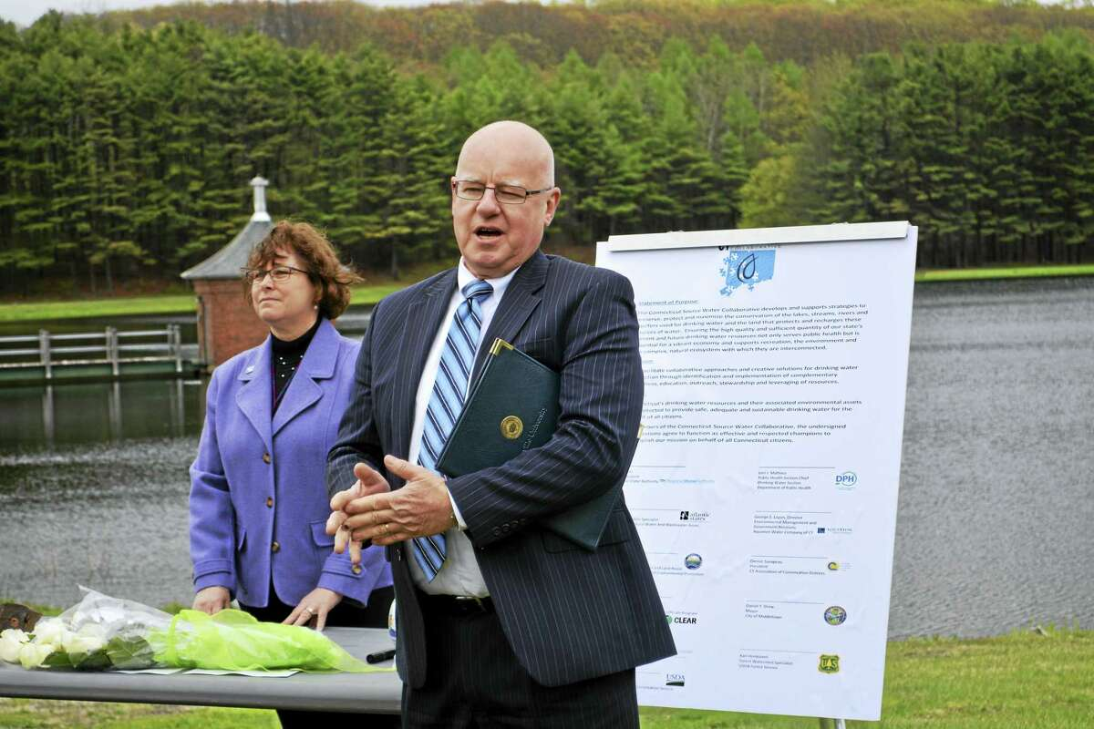 Ted Norris, vice president of the Regional Water Authority, speaks at the Middletown Water Source Collaborative Charter signing Wednesday at the Mount Higby Reservoir as environmental analyst Pat Bisacky from the state Department of Public Health's Drinking Water Section looks on.